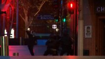A group of hostages run from Sydney cafe hostage situation