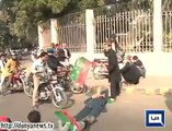 A citizen pass bike on the legs of a PTI worker who forcibly try to stop the road