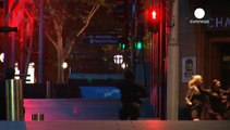 Two hostages and gunman dead after police storm Sydney café where 17 were held hostage