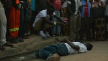 Hundreds swarm around Sierra Leone Ebola victim, take cell phones images