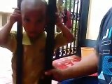 Dumb kid has his head stuck between 2 bars and his father will find the solution to help him!