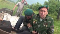 Dumb russian soldier falling from a truck head first in puddle of mud!