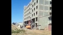Terrifying moment workers run for their lives as building demolition goes disastrously wrong