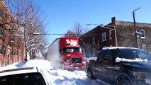 Tirer un camion bloqué dans la neige