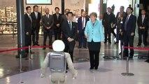 Merkel makes friends with dancing, jumping robot on Japan visit