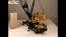 A 1-16 scale 150 ton Grove model crane lifting an 80 ton granite