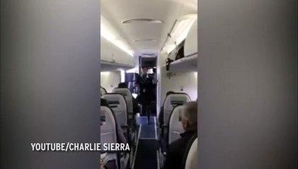 Watch a Flight Attendant Entertain Passengers by Dancing
