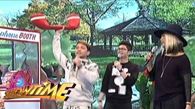How do Vice, Vhong, and Jhong use the giant telephone?