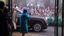 Schoolkids brave wind and rain to see Queen