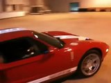 Supercar Ford GT Drifting Donuts in an Airport Hangar