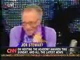 Larry King interviewing Jon Stewart