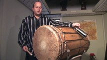 How To Play West African Drums : Playing a Dun Dun African Drum Beat