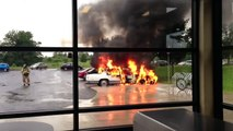 Car catches fire in front of city pool