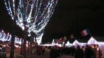 Paris by Night - Walking through the shinning Avenue des Champs Elysses