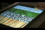 The Haptic Tabletop Puck: Tactile Feedback for Interactive Tabletops