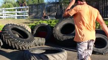 Hula-Hooping a 120 pound tractor tire -that hula-hoop guy!