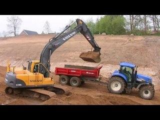 Volvo EC210B Excavator Loading John Deere And New Holland Tractors