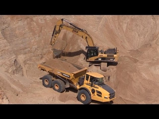 Cat 330D Excavator Loading Volvo A40F Dumpers