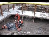 Mini Excavator working with very wet mud  - Dailymotion Video