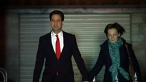 Solemn looking Ed Miliband leaves house with wife