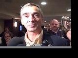 Patrick Pichette talks to reporters