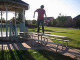 No-comply and kickflip off picnic table