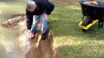 Spreading Bentonite to Fix Leaking Pond