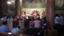 A Mass (Eucharist, Holy Communion) at the Church of Gethsemane, Mount of Olives, Jerusalem Israel