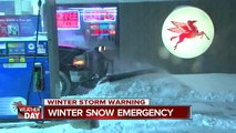 Man on skis pulled by car on city streets during snow emergency