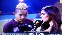 Venezuelan footballer kicked by rival fan during live interview