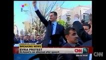 Protester attacks Assads´s car Scuffles erupt around Syrian President Bashar al-Assad's car