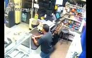 Unedited: Masked gunman confronts Machete wielding store owner (shots fired)