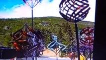 vertical axis wind turbines vawt as wind kinetic sculptures  in garden in urban area