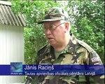Vācu armijas karavīri Latvijā uzkopj kapus