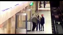 Woman pushed on Subway train tracks - Russian superhero saves the day