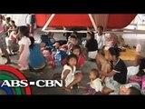 Typhoon evacuees scramble for relief goods