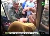 Syrian women beats captured terrorists by Syrian Arab Army