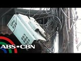 QC residents complain on dangling cables