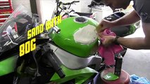 Repairing a dent in a motorcycle tank