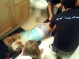 Drunk girl passed out in the bathroom