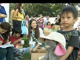 Miss Earth beauties bring smiles to typhoon survivors