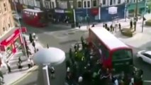 WATCH Incredible Moment A Crowd Lifts Double Decker Bus Off Trapped Unicyclist (VIDEO) RAW