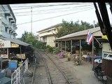 Train Runs Though Bangkok Market (SRT Maeklong line)