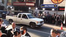 Leonardo DiCaprio Signs Autographs For Fans On Hollywood Blvd