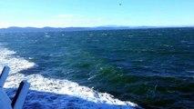 Windy crossing on the Salish Sea with rainbow