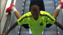 Dani Alves invents a new way to ride the escalator on the way out to Barcelona training