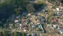 olas gigantes del tsunami come barco como terremoto golpea Japón