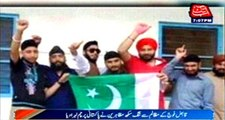 Occupied Kashmir Sikh Protesters hoist Pakistani Flag
