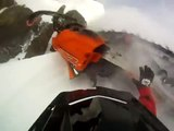 Snowmobile wipe out (On helmet cam) ! Sled wipes out at top of hill and rolls all the way back down!
