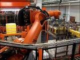 Paletizing  - Orange Juce - KUKA -  Robot System presented by Baumann Packaging Systems